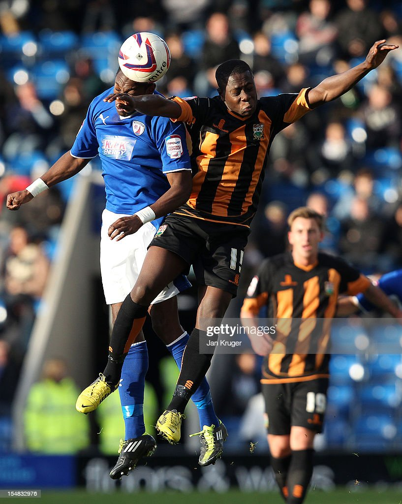 Andy Yiadom of Barnet FC challenge Nathan Smith of Chesterfield for the arial ball during the npower League Two match between Chesterfield and Barnet at Proact Stadium on October 27, 2012 in Chesterfield, England.