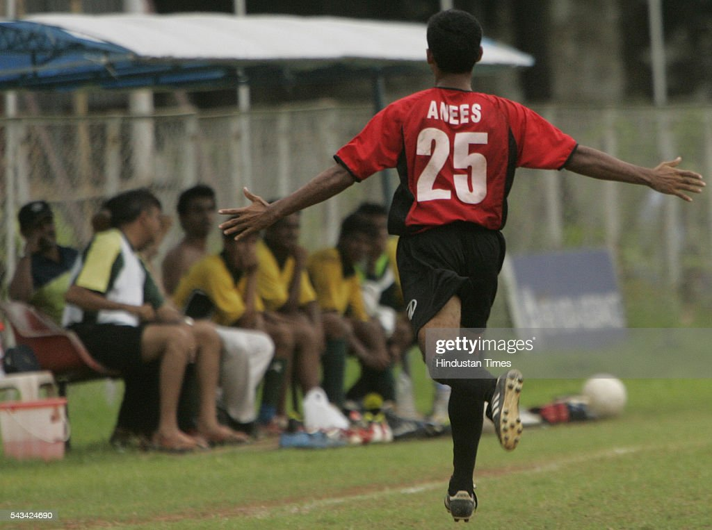K. anees (red) of mahindra united running towards the bench to celebrate after scoring his first goal against rcf during H2K-MDFA-elite division football match at cooperage on August 31, 2005.