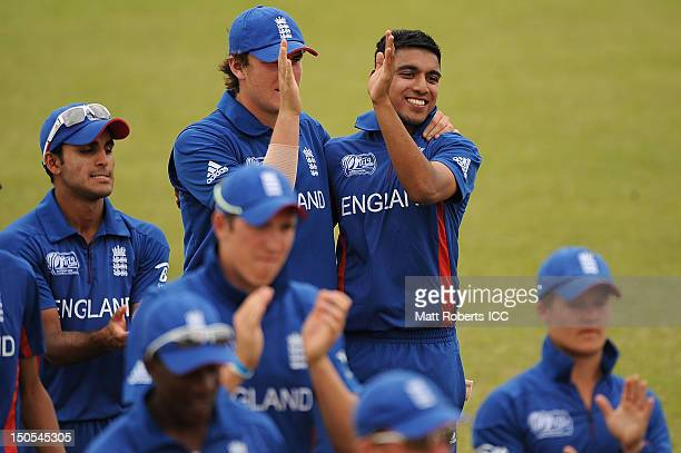 Aneesh Kapil and Adam Bell of England high five during the ICC U19 Cricket World Cup 2012 Semi Final match between Bangladesh and England at...