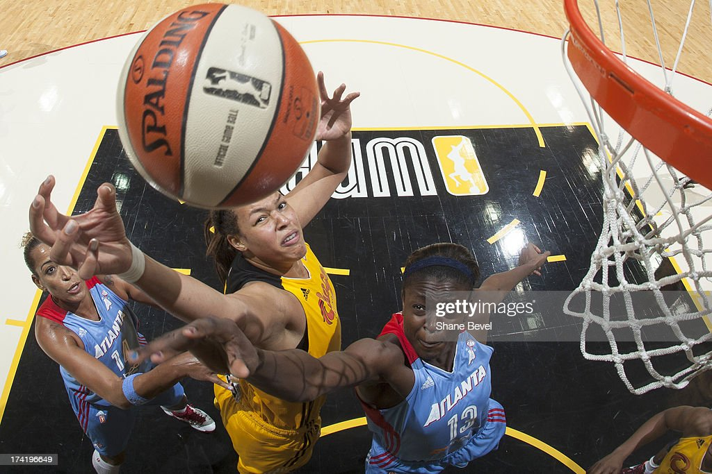 Aneika Henry #13 and Erika de Souza #14 of the Atlanta Dream battle for a rebound with Elizabeth Cambage #8 of the Tulsa Shock during the WNBA game on July 21, 2013 at the BOK Center in Tulsa, Oklahoma.