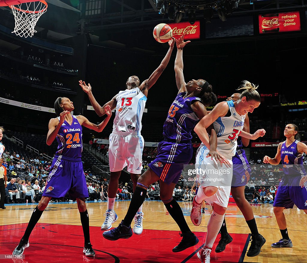 Aneika Henry of the Atlanta Dream battles for a rebound against Nakia Sanford of the Phoenix Mercury at Philips Arena on May 31 2012 in Atlanta...