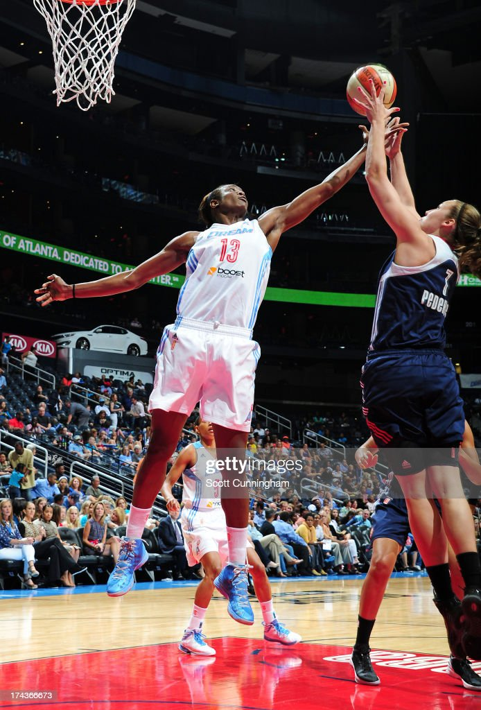 Aneika Henry #13 of the Atlanta Dream battles for a rebound against Kelsey Griffin #5 of the Connecticut Sun at Philips Arena on July 24, 2013 in Atlanta, Georgia.