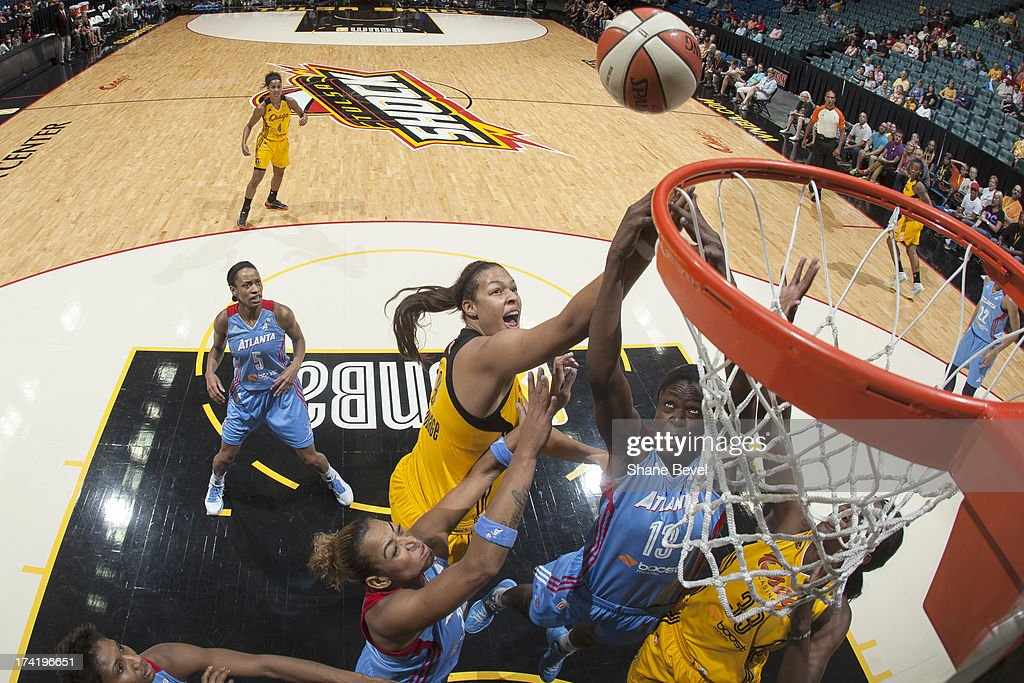 Aneika Henry #13 of the Atlanta Dream battles for a rebound with Elizabeth Cambage #8 of the Tulsa Shock during the WNBA game on July 21, 2013 at the BOK Center in Tulsa, Oklahoma.