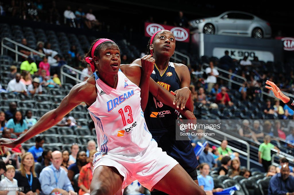 Aneika Henry #13 of the Atlanta Dream boxes out against <a gi-track='captionPersonalityLinkClicked' href=/galleries/search?phrase=Chiney+Ogwumike&family=editorial&specificpeople=6866662 ng-click='$event.stopPropagation()'>Chiney Ogwumike</a> #13 of the Connecticut Sun on July 29, 2014 at Philips Arena in Atlanta, Georgia.