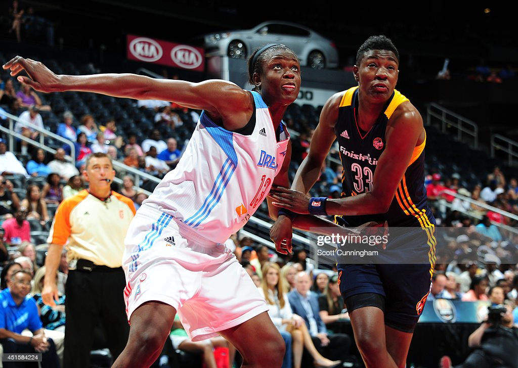 Aneika Henry #13 of the Atlanta Dream boxes out against Natasha Howard #33 of the Indiana Fever on July 1, 2014 at Philips Arena in Atlanta, Georgia.