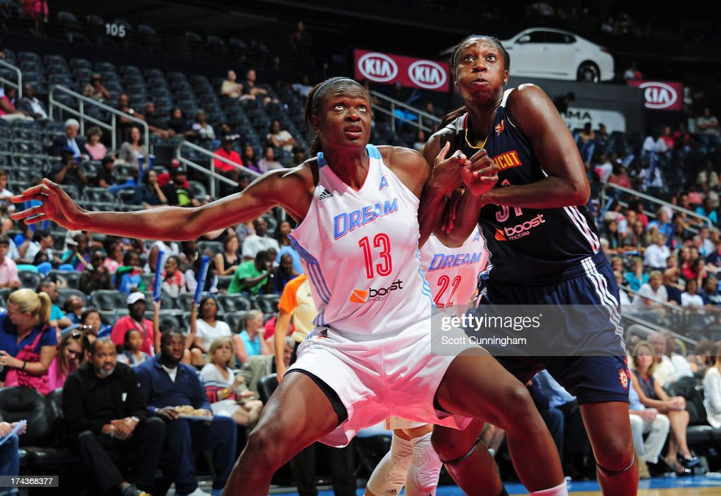 Aneika Henry #13 of the Atlanta Dream boxes out against Tina Charles #31 of the Connecticut Sun at Philips Arena on July 24, 2013 in Atlanta, Georgia.