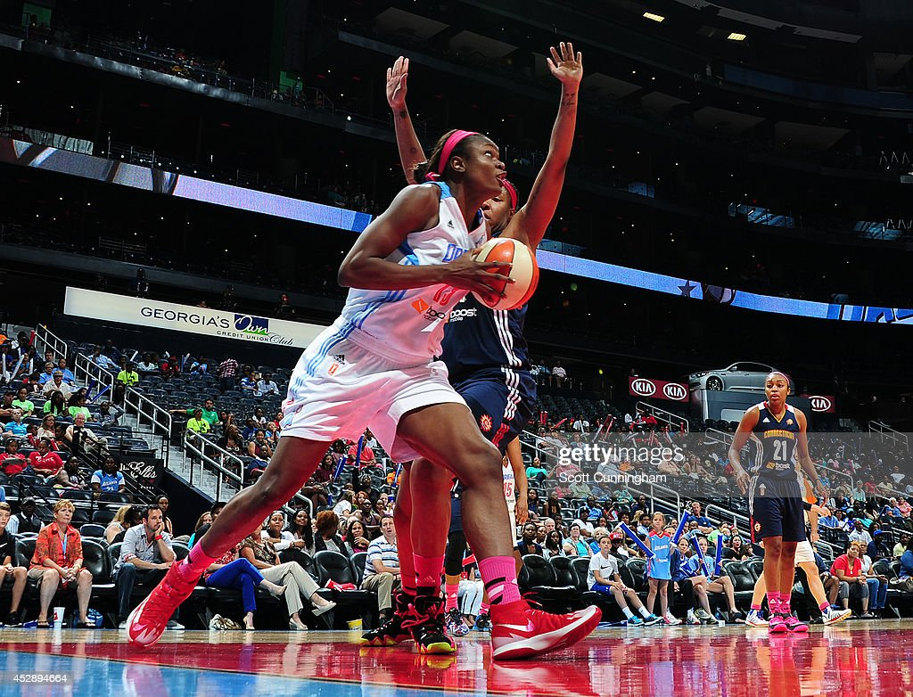 Aneika Henry #13 of the Atlanta Dream drives against the Connecticut Sun on July 29, 2014 at Philips Arena in Atlanta, Georgia.