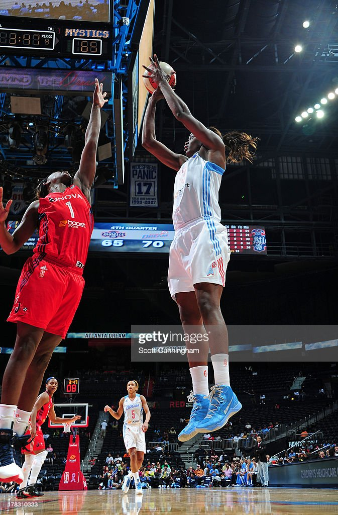 Aneika Henry #13 of the Atlanta Dream puts up a shot against the Washington Mystics at Philips Arena on August 28 2013 in Atlanta, Georgia.