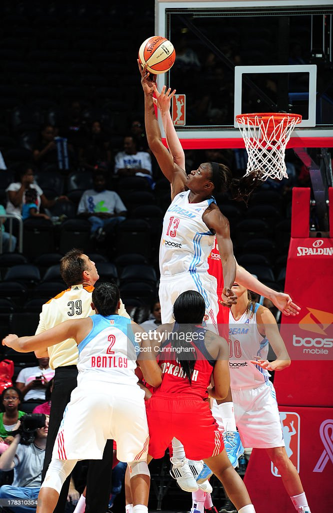 Aneika Henry #13 of the Atlanta Dream wins a tip against the Washington Mystics at Philips Arena on August 28 2013 in Atlanta, Georgia.
