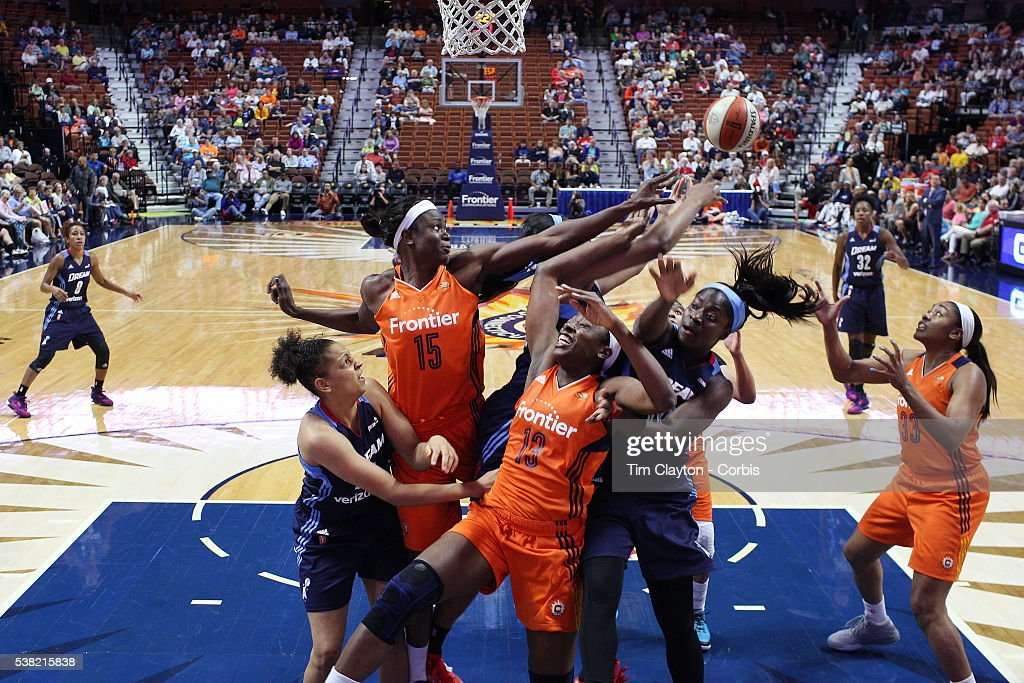 Aneika HenryMorello and Chiney Ogwumike of the Connecticut Sun challenge for a rebound with Matee Ajavon and Rachel Hollivay of the Atlanta Dream...