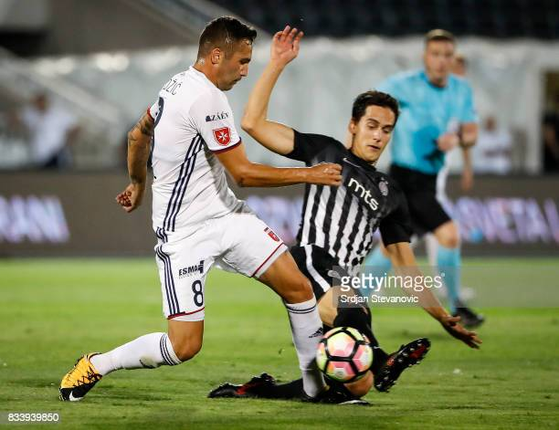 Anel Hadzic of Videoton in action against Marko Jevtovic of Partizan during the UEFA Europa League Qualifying PlayOffs round first leg match between...