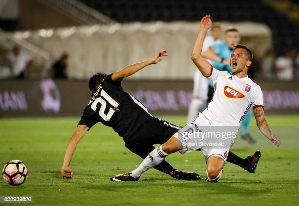 Anel Hadzic of Videoton is challenged by Marko Jevtovic of Partizan during the UEFA Europa League Qualifying PlayOffs round first leg match between...