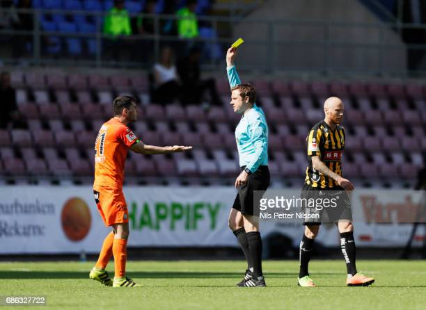 Anel Rashkaj of Athletic FC Eskilstuna is shown a yellow card by referee Markus Strombergsson during the Allsvenskan match between Athletic...
