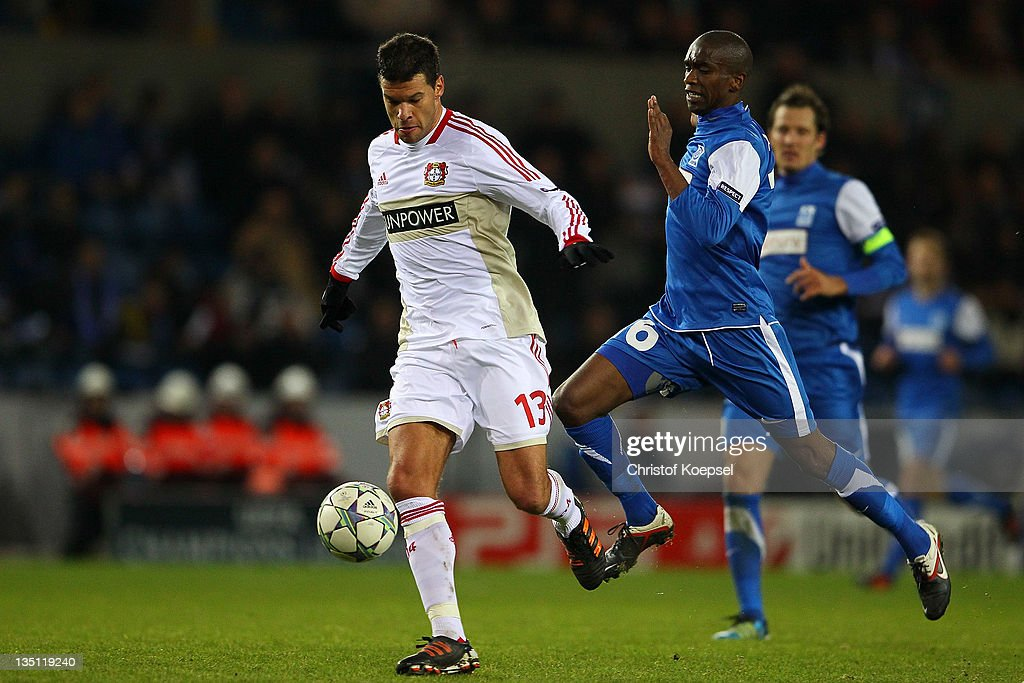 Anele Ngongca of Genk (R) challenges <a gi-track='captionPersonalityLinkClicked' href=/galleries/search?phrase=Michael+Ballack&family=editorial&specificpeople=202166 ng-click='$event.stopPropagation()'>Michael Ballack</a> of Leverkusen (L) during the UEFA Champions League group E match between KRC Genk and Bayer 04 Leverkusen at Cristal Arena on December 6, 2011 in Genk, Belgium.