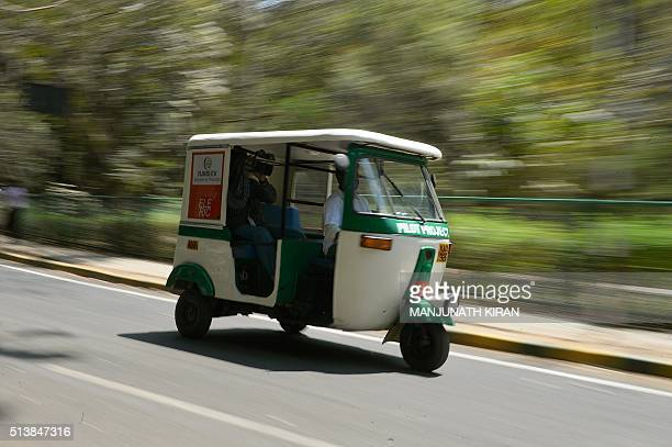 An'ElericAuto'solar powered auto rickshaw which runs on electricity travels on a street in Bangalore on March 5 2016 The southern Indian city is host...