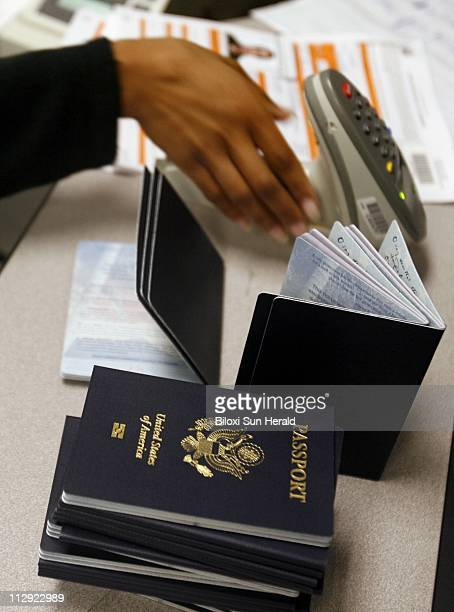 Aneshia Darensburg scans in passports to be printed while working at the US Government Passport Office in New Orleans Louisiana on Thursday July 20...