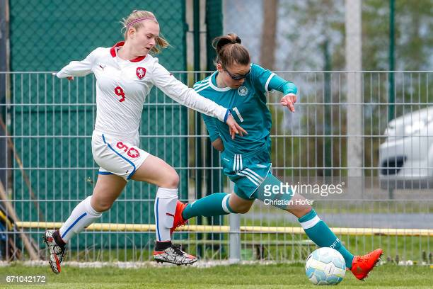 Aneta Buryanova of Czech Republic challenges Julia Pollak of Germany for the ball during the Under 15 girls international friendly match between...