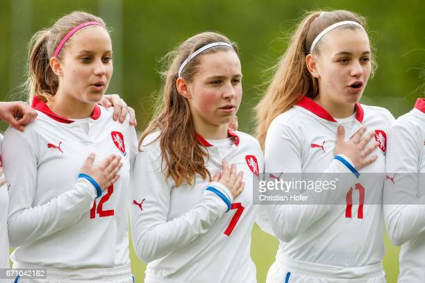 Aneta Sovakova Katerina Furikova and Andre Hola of Czech Republic line up during the national anthem prior to the Under 15 girls international...