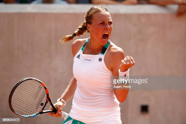 Anett Kontaveit of Estonia celebrates during the ladies singles first round match against Monica Niculescu of Romania on day two of the 2017 French...