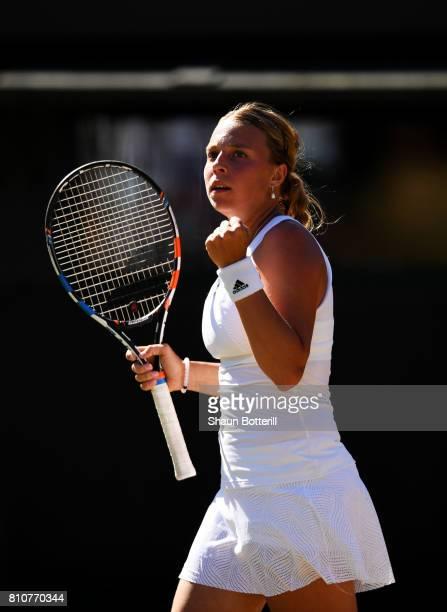 Anett Kontaveit of Estonia celebrates during the Ladies Singles third round match against Caroline Wozniacki of Denmark on day six of the Wimbledon...