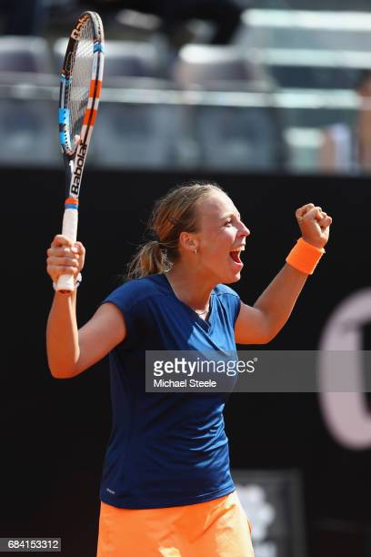 Anett Kontaveit of Estonia celebrates her straight sets victory against Angelique Kerber of Germany in the women's second round match on Day Four of...