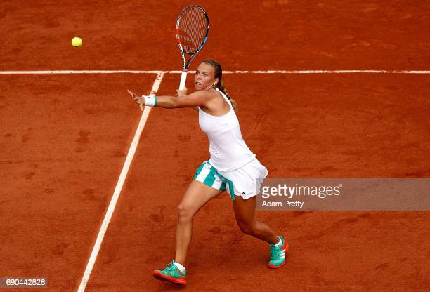 Anett Kontaveit of Estonia hits a forehand during the second round match against Garbine Muguruza of Spain on day four of the 2017 French Open at...