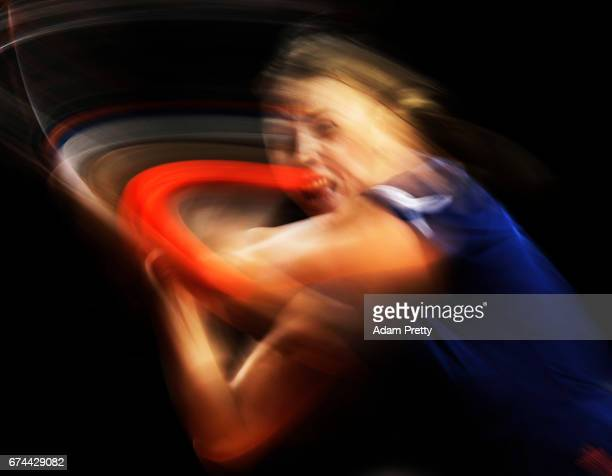 Anett Kontaveit of Estonia plays a backhand during her match against Maria Sharapova of Russia during the Porsche Tennis Grand Prix at Porsche Arena...