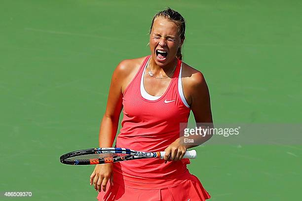 Anett Kontaveit of Estonia reacts against Madison Brengle of the United States during their Women's Singles Third Round match on Day Five of the 2015...