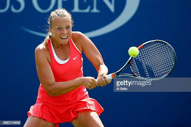 Anett Kontaveit of Estonia returns a shot to Anastasia Pavlyuchenkova of Russia during their Women's Singles Second Round match on Day Three of the...