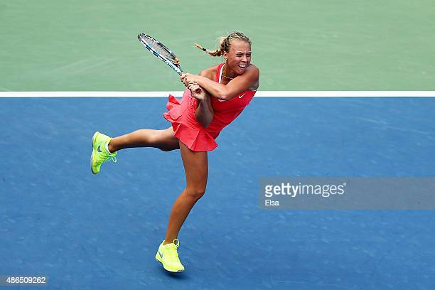 Anett Kontaveit of Estonia returns a shot to Madison Brengle of the United States during their Women's Singles Third Round match on Day Five of the...