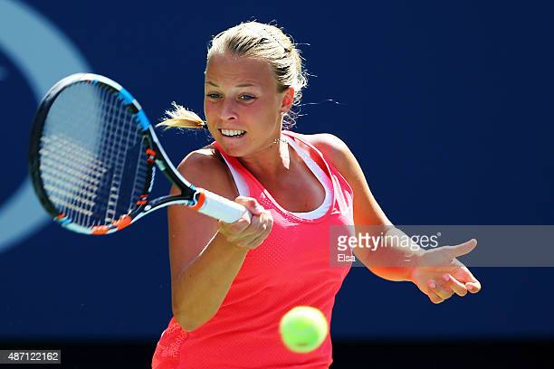 Anett Kontaveit of Estonia returns a shot to Venus Williams of the United States during their Women's Singles Fourth Round match on Day Seven of the...