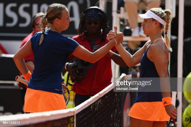 Anett Kontaveit of Estonia shakes hands with Angelique Kerber of Germany after her straight sets victory in the women's second round match on Day...