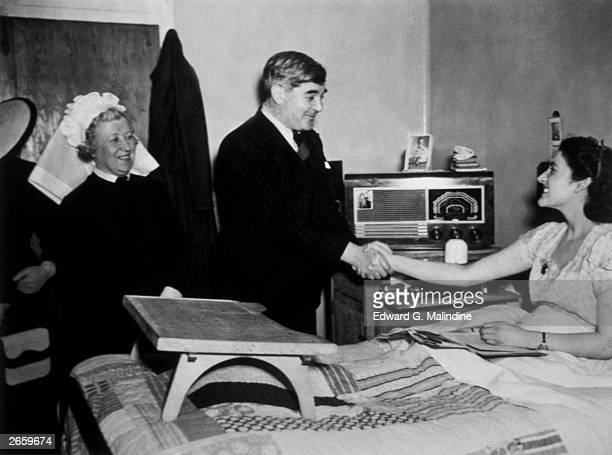 Aneurin Bevan Minister of Health meeting a patient at Papworth Village Hospital This centre for tubercular cases was taken over by the National...
