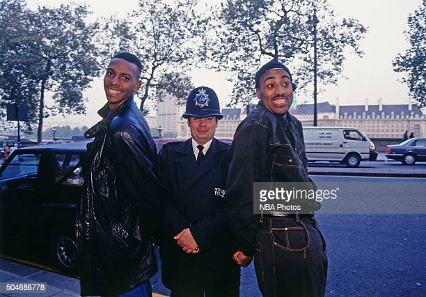 Anfernee Hardaway and Dennis Scott of the Orlando Magic pose with a police officer on October 29 1993 in London England NOTE TO USER User expressly...