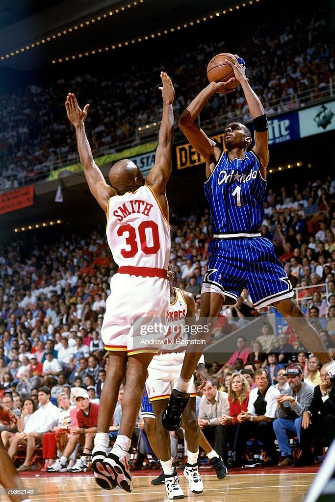 Anfernee Hardaway of the Orlando Magic attempts a shot against Kenny Smith of the Houston Rockets in Game Three of the 1995 NBA Finals at the Summit...