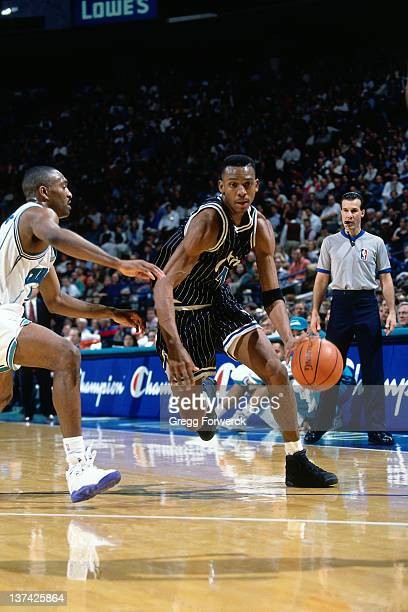 Anfernee Hardaway of the Orlando Magic dribbles against the Charlotte Hornets circa 1995 at the Charlotte Coliseum in Charlotte North Carolina NOTE...