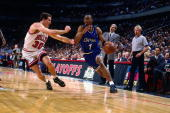 Anfernee Hardaway of the Orlando Magic drives to the basket against Jud Buechler of the Chicago Bulls in Game Six of the Eastern Conference...