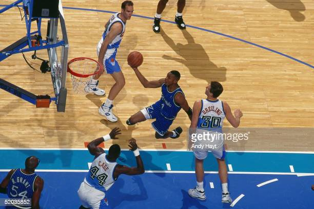 Anfernee Hardaway of the Orlando Magic drives to the basket for a layup against the Cleveland Cavaliers during the NBA game on January 11 1995 in...