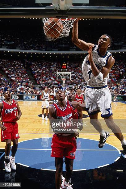 Anfernee Hardaway of the Orlando Magic dunks against the Los Angeles Clippers circa 1995 at the Orlando Arena in Orlando Florida NOTE TO USER User...