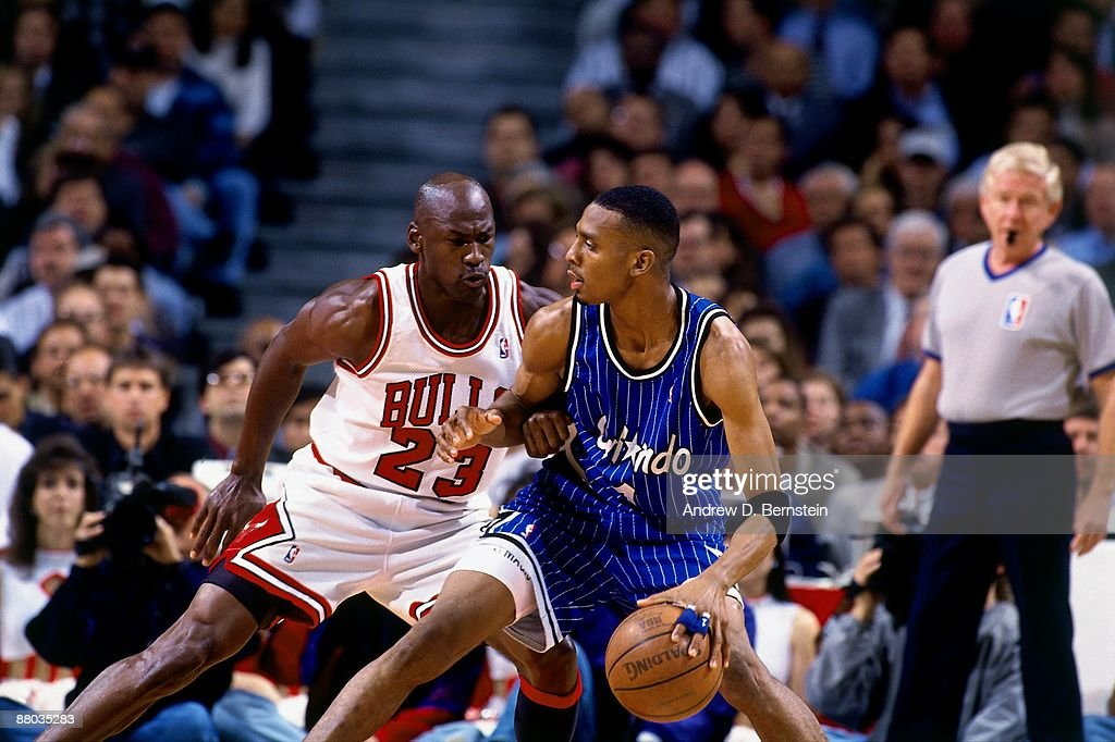 Anfernee Hardaway #1 of the Orlando Magic moves the ball against Michael Jordan #23 of the Chicago Bulls in Game Six of the Eastern Conference Semifinals during the 1995 NBA Playoffs at the United Center on May 18, 1995 in Chicago, Illinois. The Orlando Magic defeated the Chicago Bulls 108-102 and won the series 4-2.