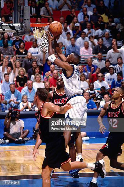 Anfernee Hardaway of the Orlando Magic shoots a layup against PJ Brown and Jamal Mashburn of the Miami Heat during Game 3 in Round 1 of the Eastern...
