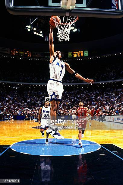 Anfernee Hardaway of the Orlando Magic shoots against the Chicago Bulls circa 1995 at the Orlando Arena in Orlando Florida NOTE TO USER User...