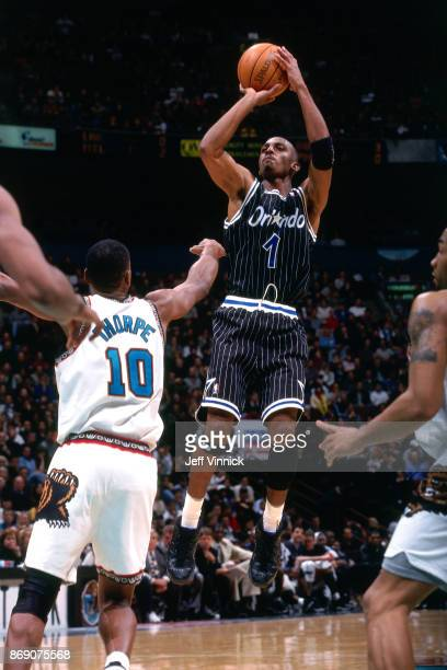 Anfernee Hardaway of the Orlando Magic shoots against the Vancouver Grizzlies circa 1998 at the General Motors Palace in Vancouver BC NOTE TO USER...