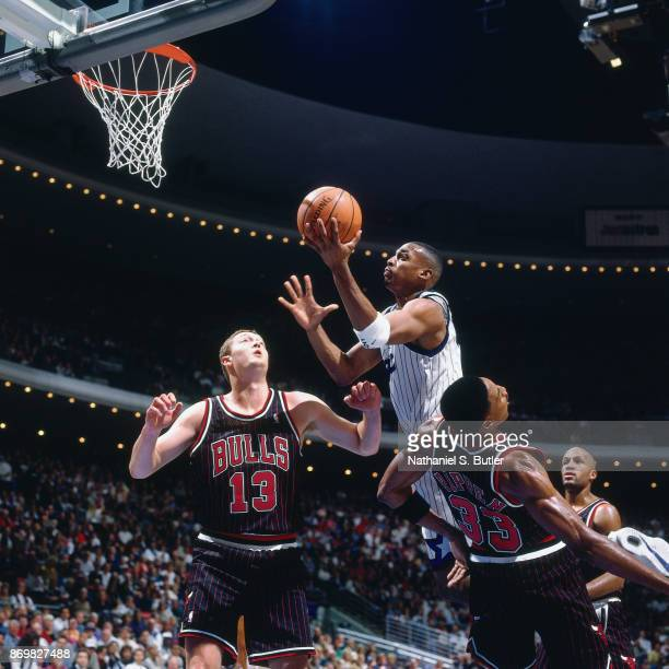 Anfernee Hardaway of the Orlando Magic shoots on November 14 1995 at the Orlando Arena in Orlando Florida NOTE TO USER User expressly acknowledges...