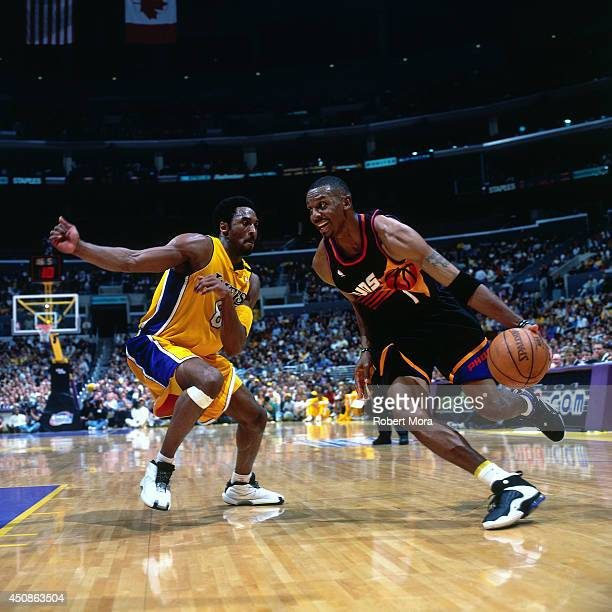 Anfernee Hardaway of the Phoenix Suns drives to the basket against Kobe Bryant of the Los Angeles Lakers on May 16 2000 at Staples Center in Los...