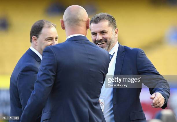 Ang Postecoglou shakes hands with Kevin Muscat the coach of the Victory during the round two ALeague match between Melbourne Victory and Melbourne...