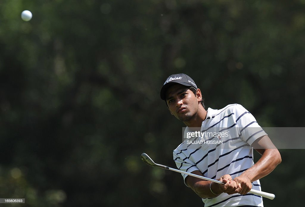 Angad Cheema of India plays a shot during the Panasonic Open India at the Delhi Golf Club in New Delhi on April 6, 2013. The 300 000 US dollar tournament is being played from April 4-7. AFP PHOTO / SAJJAD HUSSAIN