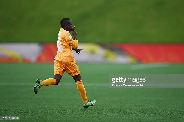 Ange Nguessan of Cote D'Ivoire celebrates as she scores the opening goal during the FIFA Women's World Cup Canada 2015 Group B match between Cote...