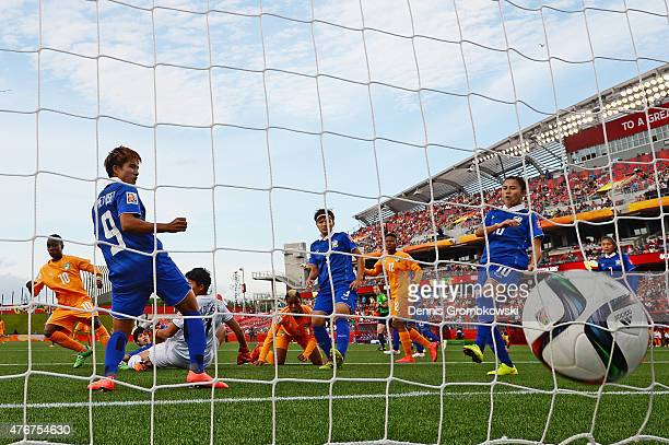 Ange Nguessan of Cote D'Ivoire scores the opening goal during the FIFA Women's World Cup Canada 2015 Group B match between Cote D'Ivoire and Thailand...