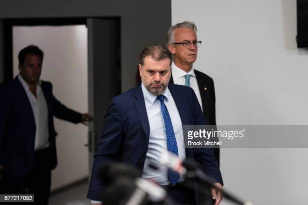 Ange Postecoglou arrives with FFA chief executive David Gallop to announce he will step aside from his role as coach of the Socceroos during a FFA...